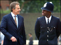 Blair with policeman
