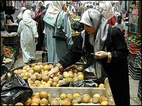 A Palestinian refugee forced to buy rotten lemons in Ain al-Hilweh camp in Lebanon