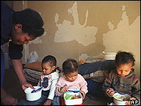 Brazilian family at a building occupied illegally in Sao Paulo in September 2003