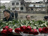 Relatives of victims with flowers