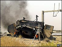 Burnt out Humvee in Iraq after an attack on US troops on Wednesday