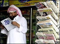 Saudi man reading a magazine