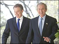 Tony Blair and George Bush walk to their news conference