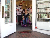 Photo of Julie Fernandez emerging from Haight Ashbury hairdresser