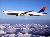 A Delta aircraft flying over a mountain range