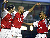 Robert Pires, Thierry Henry and Gilberto celebrate for Arsenal