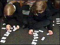 children working with number cards