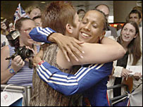 Kelly Holmes is reunited with her mother at Gatwick Airport