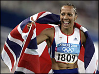 Kelly Holmes draped in a UK flag