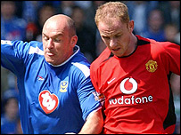 Portsmouth midfielder Steve Stone (left) tussles with Man Utd's Nicky Butt