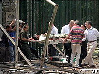 A casualty is taken away on a stretcher after the blast in Jakarta - September 2004