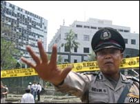 A policeman near the site of the bomb blast