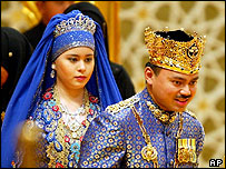 Crown Prince Al-Muhtadee Billah Bolkiah, right, is followed by Sarah Salleh - 9 sep 04