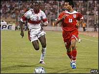 Khaled Sallam of Jordan (L) vies with Iran's Hossein Kabi (R) during their World Cup 2006 qualifying football match in Amman