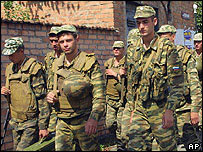 Russian soldiers outside besieged Beslan school