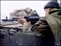 A Russian soldier on the outskirts of Grozny in 1999