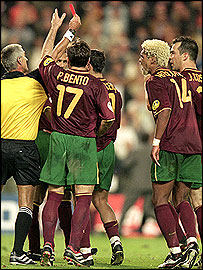 Nuno Gomes of Portugal is sent off by referee Gunter Benko during the Euro 2004 semi-final against France