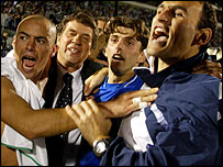 Greece's coach Otto Rehhagel (second left) celebrates with his players after qualifying for Euro 2004