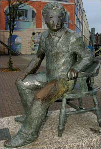 Dylan Thomas statue wearing an Ospreys mask