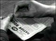 Hands tear up ration book