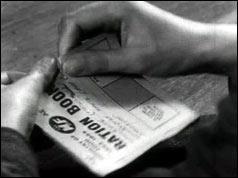 Hands tear up ration book