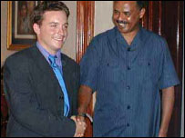BBC's Jonah Fisher and President Isaias Afewerki shaking hands