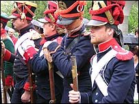 Soldiers dressed in traditional Russian uniforms from the era