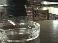A cigarette in a bar ashtray