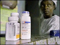A Nigerian woman waits for drugs donated by Aids sufferers in the US