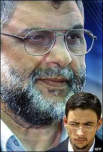 Mohammad Rantissi under portrait of his father in Gaza City