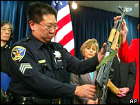 A San Francisco police officer shows off an assault rifle