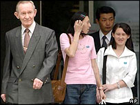 Mr Jenkins and his two daughters leave hospital in Tokyo for the US military base