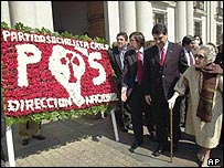 Allende's widow Hortensia Bussi, right, looks at a floral tribute from the Socialist Party