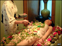 A woman covered in sushi in the Kunming restaurant in China