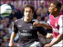 Chelsea's Joe Cole (left) and Villa's JLloyd Samuel battle for the ball at Villa Park