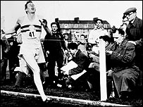 Roger Bannister runs the first four-minute mile