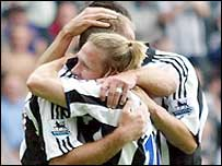 Newcastle players celebrate Alan Shearer's goal