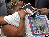 Two people embrace during the ceremonies at Ground Zero
