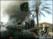 Burning US armoured vehicle on Haifa Street