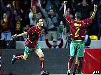 Portugal's Pauleta (left) celebrates after scoring against Greece, 15 Nov 03