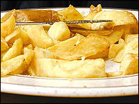 Plate of chips and a sausage