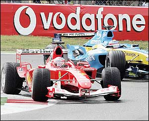 Barrichello and Alonso grapple for position in overcast conditions at Monza
