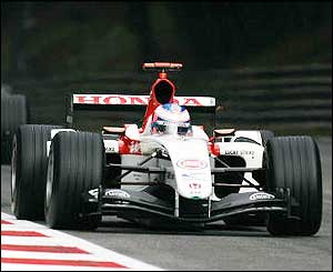 Button is chased by the pack but can't hold off the challenge of the Ferrari drivers