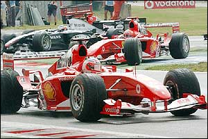 Schumacher appears unwilling to challenge Barrichello for the lead and tucks into second place