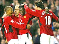 Louis Saha (centre) is congratulated by his Manchester United team-mates