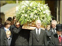 Keating's coffin being carried into church