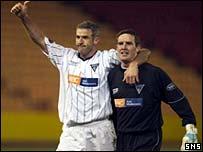 Craig Brewster and Derek Stillie salute the fans