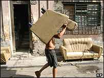 Man moves furniture from his Havana home