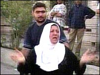 Woman at site of one of the Basra blasts