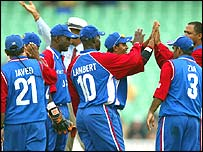 The US celebrate taking a wicket during their match against New Zealand